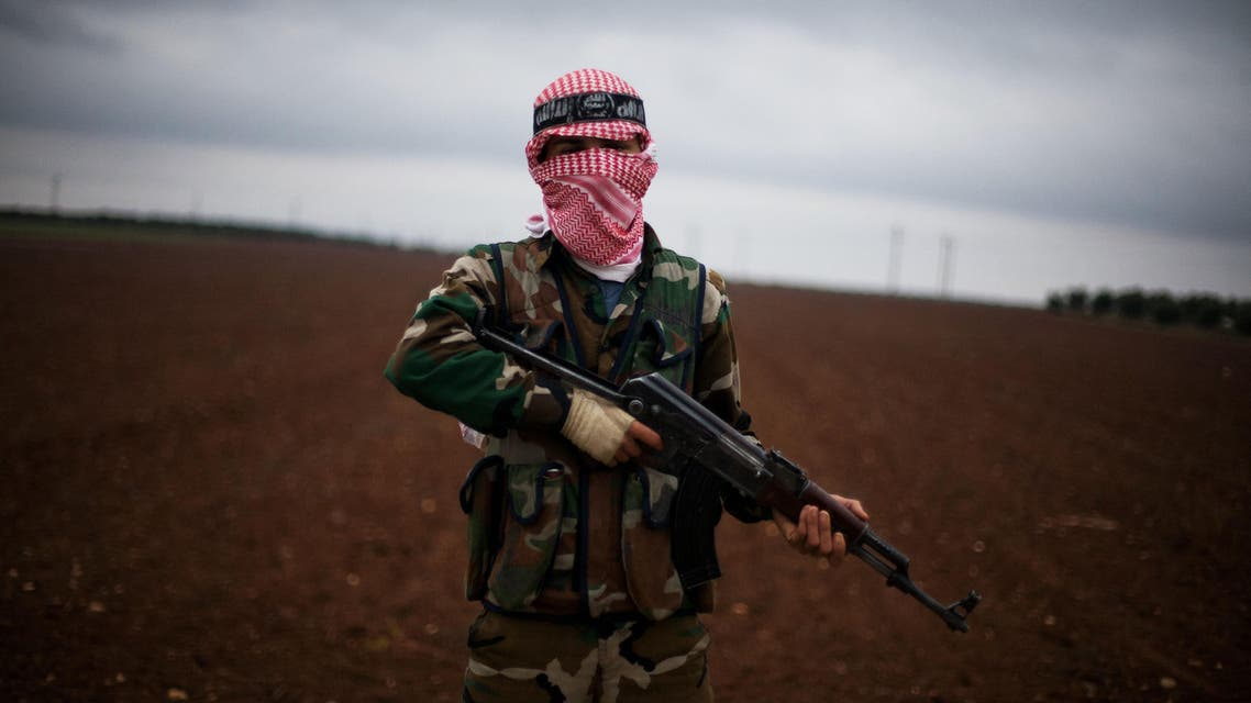 A Free Syrian Army fighter takes position close to a military base, near Azaz, Syria, Monday, Dec. 10, 2012. (AP)