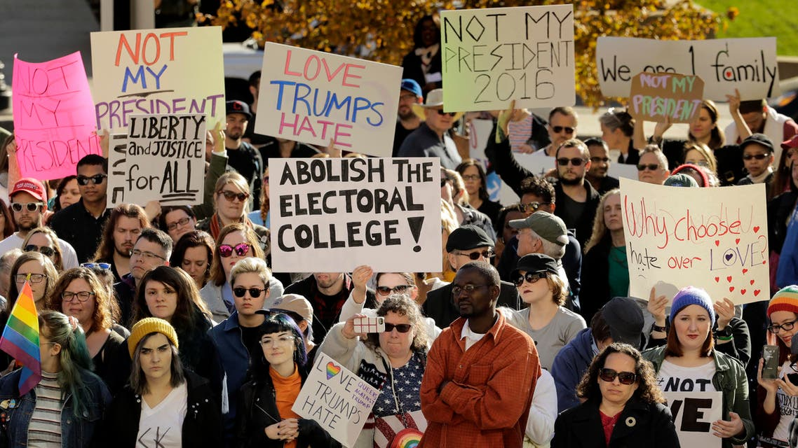 People protest against the election of President-elect Donald Trump Saturday, Nov. 12, 2016, in front of City Hall in Kansas City, Mo. Thousands took to the streets Saturday across the United States as demonstrations against Trump continued in New York, Chicago, Los Angeles and beyond. (AP)