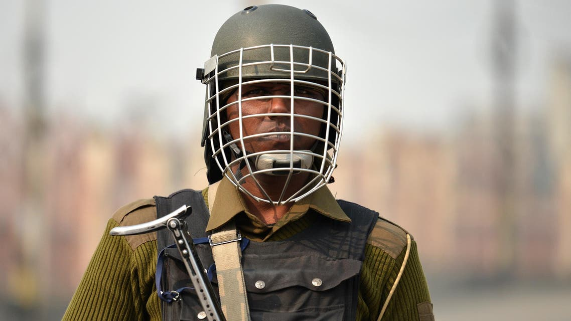 An Indian paramilitary trooper stands guard during curfew and restrictions in downtown Srinagar as the unrest in Kashmir enters 126th day on November 11, 2016. More than 90 civilians have been killed and thousands injured during the latest protests against Indian rule, sparked by the killing on July 8 of a popular rebel leader of Hizbul Mujahieed during a gunfight with Indian soldiers.Kashmir has been divided between India and Pakistan since their independence from British rule in 1947. Both claim the territory in full. TAUSEEF MUSTAFA / AFP