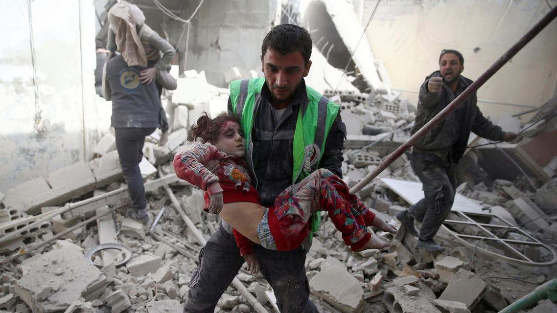 civil defence member carries an injured girl after an airstrike in the rebel-held Douma neighbourhood of Damascus, Syria November 7, 2016. reuters