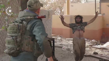 Moment an ISIS militant surrenders in Mosul