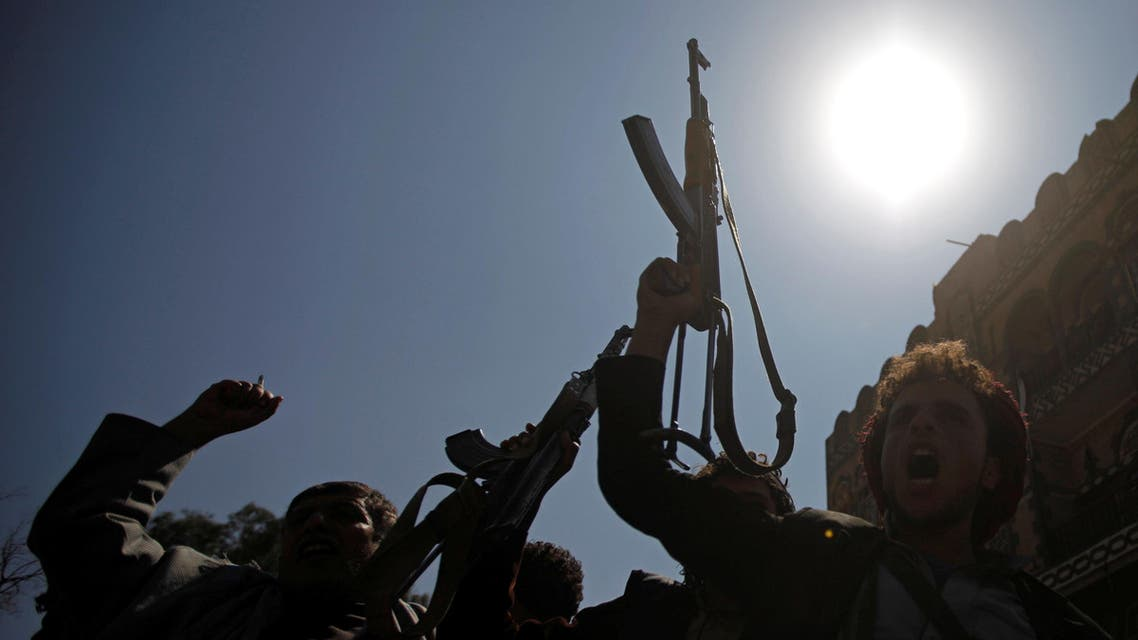 Pro-Houthi protesters wave their weapons as they shout slogans against a U.N.-proposed peace plan for Yemen during a demonstration outside a hotel where the U.N. envoy for Yemen, Ismail Ould Cheikh Ahmed, is staying in Sanaa, Yemen, November 5, 2016. (AP)
