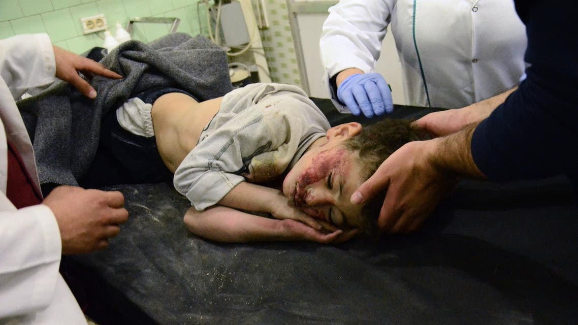 An injured child receives treatment at the University hospital in a government-held neighbourhood on November 3, 2016 following reported rebel fire on government-held parts of the northern city of Aleppo. Rebel fire on government-held parts of Syria's Aleppo killed 12 civilians and wounded 200, state news agency SANA reported. The Syrian Observatory for Human Rights gave a toll of 11 civilians killed, including four children, and at least 100 people wounded.  GEORGE OURFALIAN / AFP