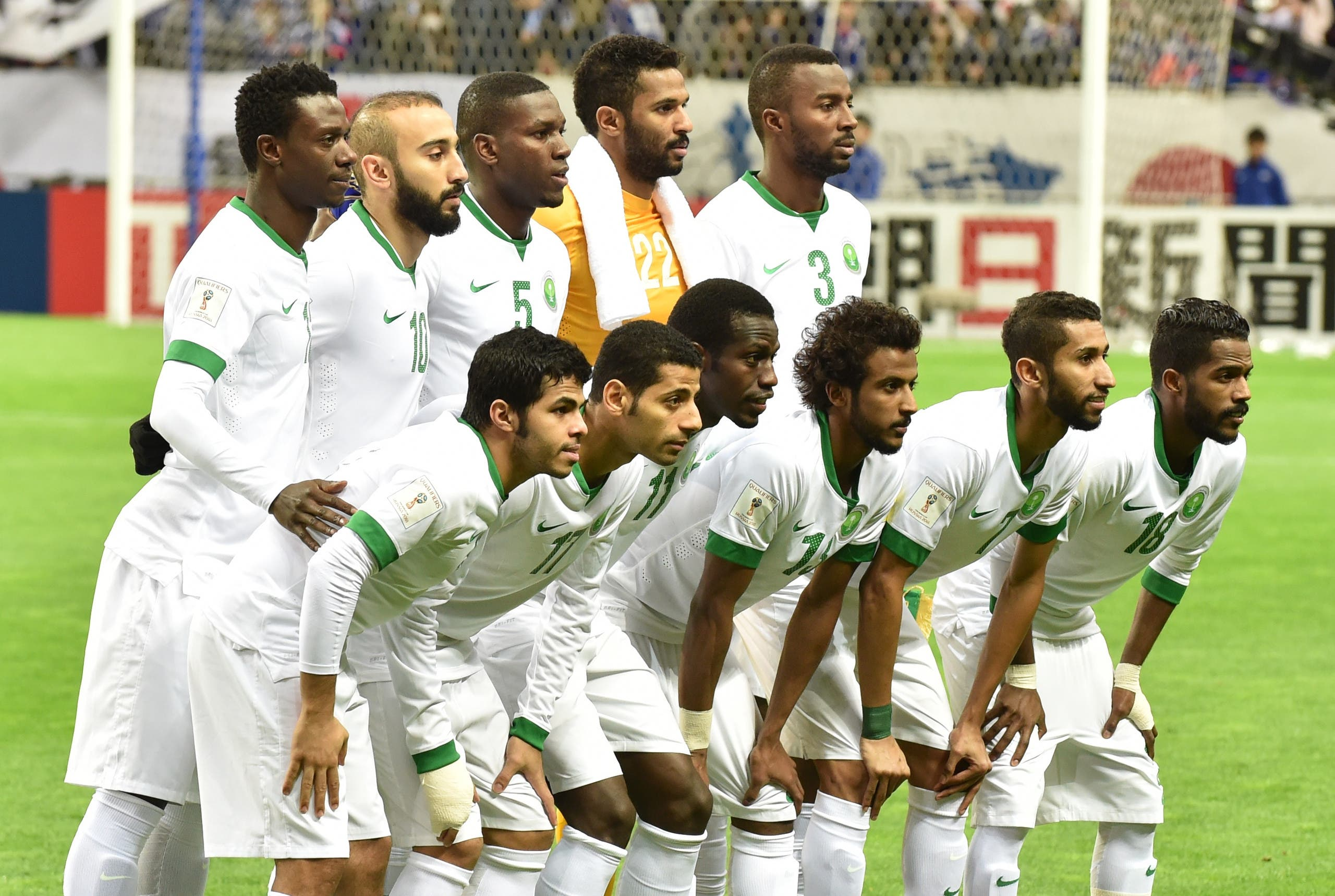 Saudi Arabia's starting players pose during a photo session prior to their football match in Group B of the 2018 World Cup Asian qualifier against Japan at Saitama Stadium in Saitama on November 15, 2016.  KAZUHIRO NOGI / AFP