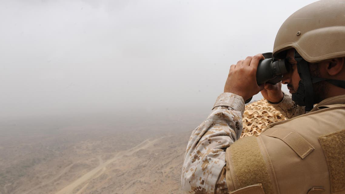 A Saudi soldier looks through binoculars from a position at al-Dokhan mountain, on the Saudi-Yemeni border, in southwestern Saudi Arabia, on April 13, 2015. AFP