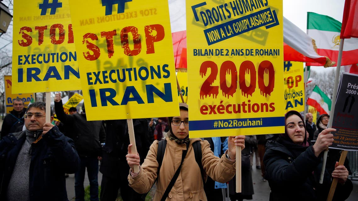 Supporters of Maryam Rajavi, President of the National Council of Resistance of Iran, demonstrate against the Iranian President Hassan Rouhani's visit in Paris, Wednesday, Jan. 27, 2016. (AP)