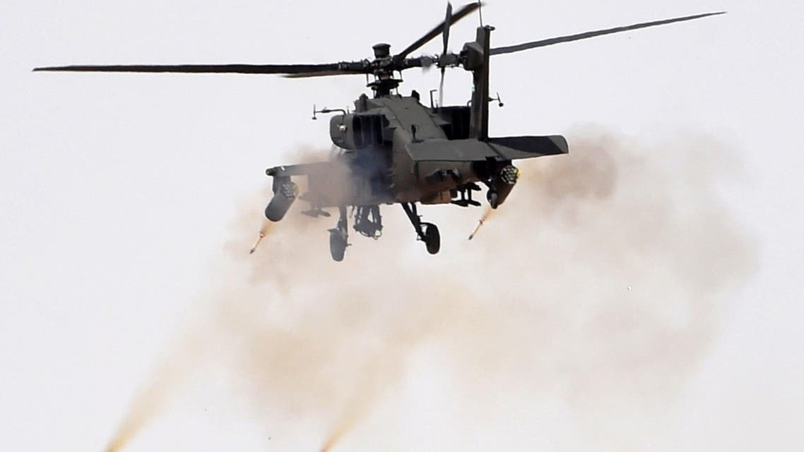 """A picture taken on March 10, 2016 shows smoke billowing after an apache helicopter fired during the Northern Thunder military exercises in Hafr al-Batin, 500 kilometres north-east of the Saudi Capital Riyadh. Warplanes roared overhead, tanks rumbled across the desert and smoke filled the sky for the final day of what Saudi Arabia billed as the region's biggest-ever military exercises. The 12-day """"Northern Thunder"""" manoeuvres in the kingdom's northeast included 20 nations from the Middle East, Africa and Asia, Saudi officials said. FAYEZ NURELDINE / AFP"""