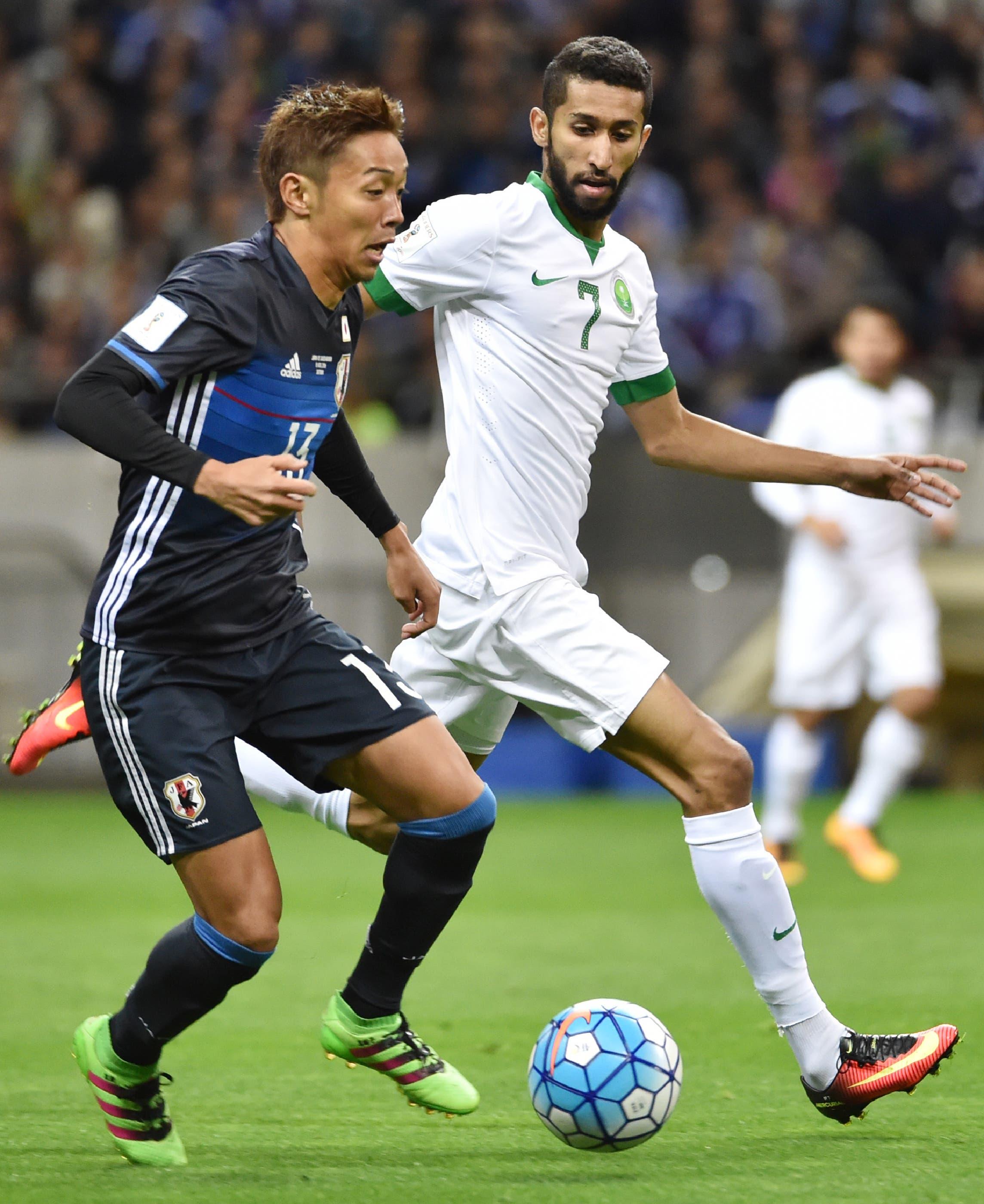 Japan's midfielder Hiroshi Kiyotake (L) and Saudi Arabia's midfielder Salman Alfaraj (R) fight for the ball during their football match in Group B of the 2018 World Cup Asian qualifier at Saitama Stadium in Saitama on November 15, 2016.  KAZUHIRO NOGI / AFP