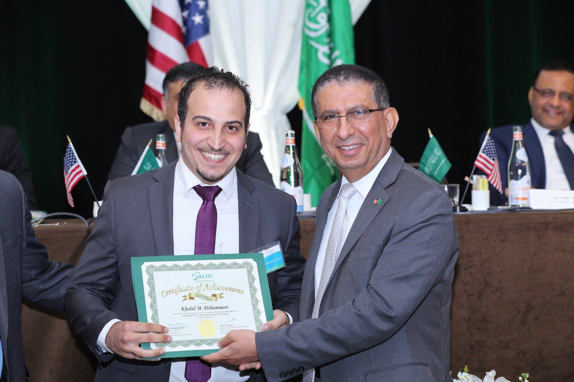 Saudi student Khalid al-Qhes al-Shammeri awarded by his university for his Saudi club's efforts. (Supplied)