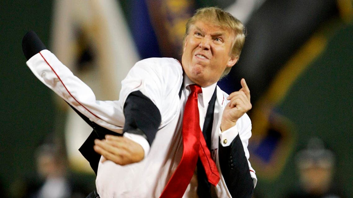 Donald Trump throws out the ceremonial first pitch before the start of the game between the Boston Red Sox and the New York Yankees in the second game of a day/night doubleheader Friday, Aug.18, 2006, at Fenway Park in Boston. (AP