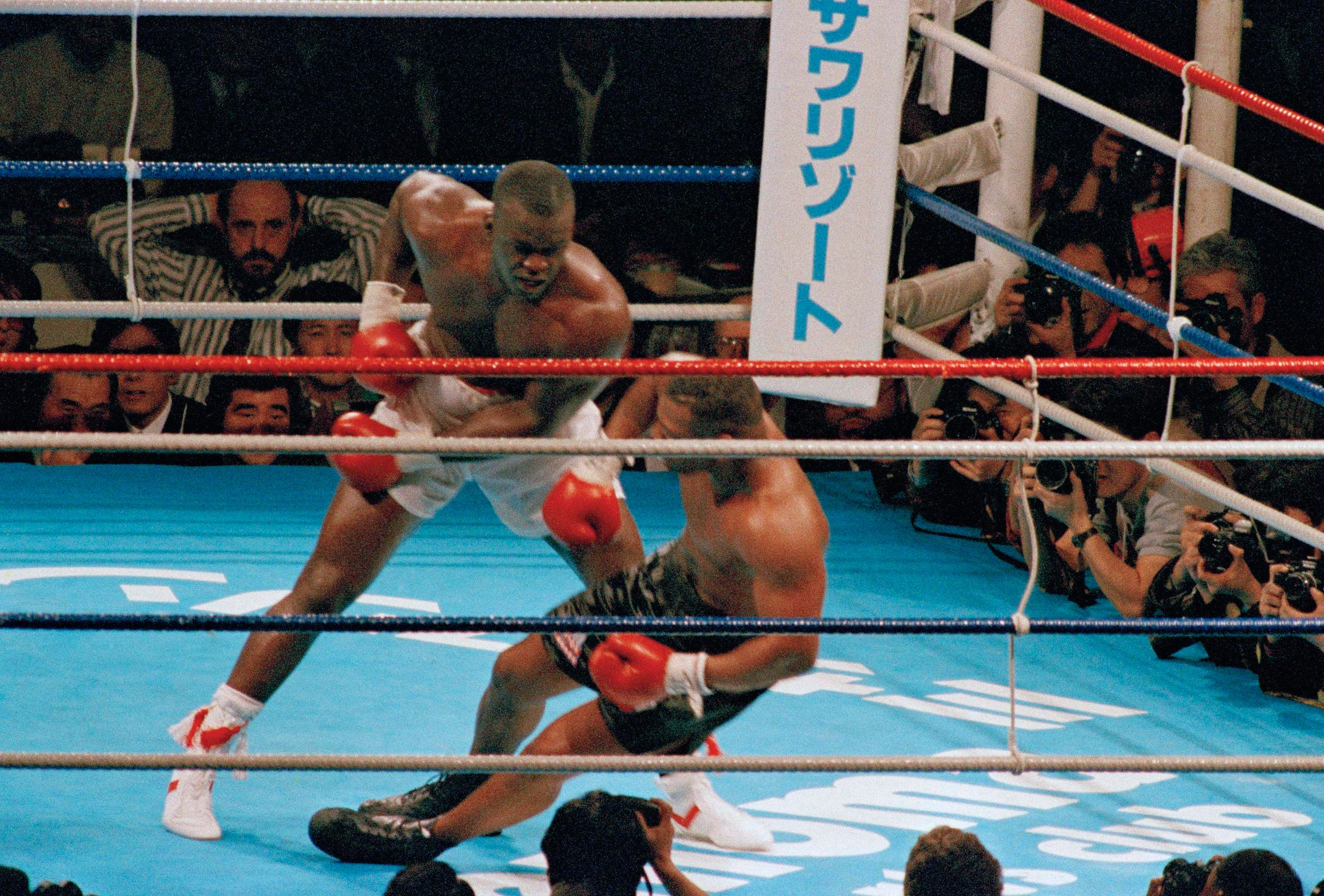 In this Feb. 11, 1990, file photo, James Douglas follows with a left, dropping Mike Tyson to the canvas in the 10th round of scheduled 12-round heavyweight champion bout at the Tokyo Dome in Tokyo. Tyson, the youngest heavyweight champion in boxing history, comes into the bout 37-0 with 33 knockouts, while the unknown Douglas is 29-4-1 with 19 KOs. (AP)