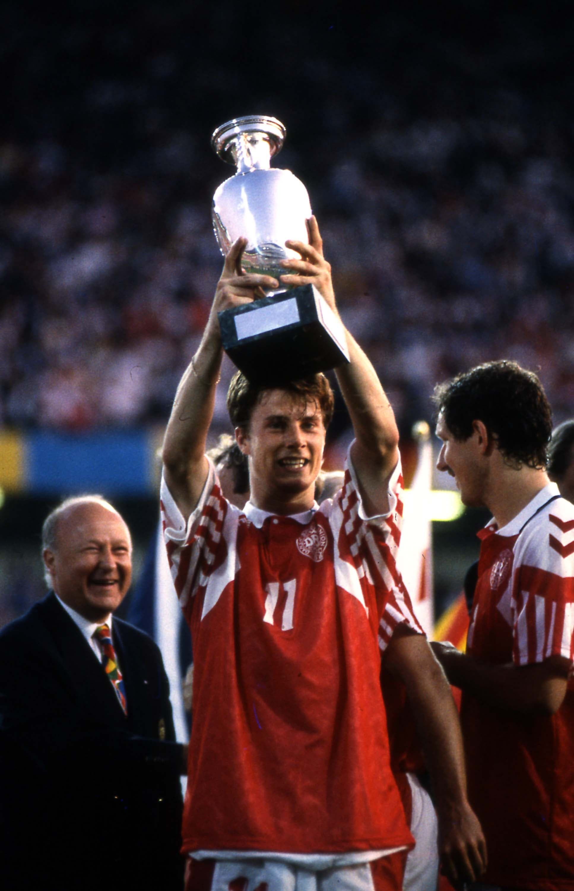 Brian Laudrup, at center, of Denmark soccer team lifts the trophy after winning the final game of the European soccer Championships, on June 26, 1992 in Goteborg, Sweden. Denmark defeated Germany 2-0 to win the Championship. (AP)