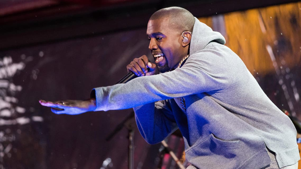 Kanye West performs during the World AIDS Day (RED) concert In Times Square on Monday, Dec. 1, 2014 in New York. (Photo by Charles Sykes/Invision/AP)