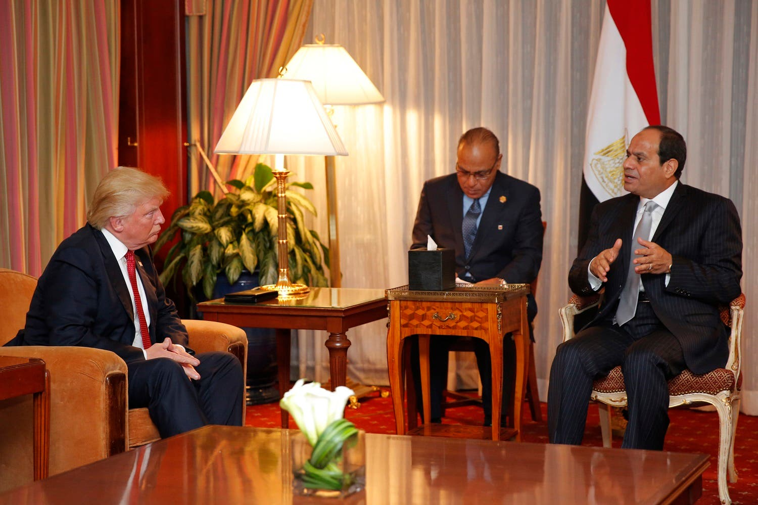 Presidential-Elect Donald Trump looks on as Egyptian President Abdel Fattah el-Sisi speaks during their meeting in September. (AFP)