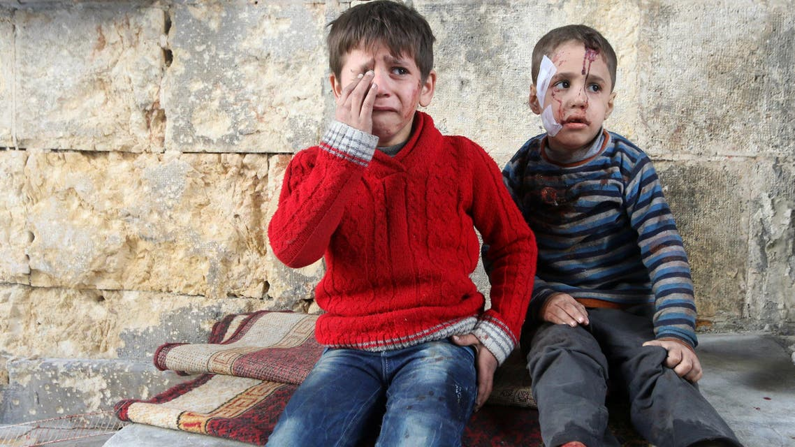 Injured boys react at a field hospital after airstrikes on the rebel held areas of Aleppo, Syria November 18, 2016. (Reuters)
