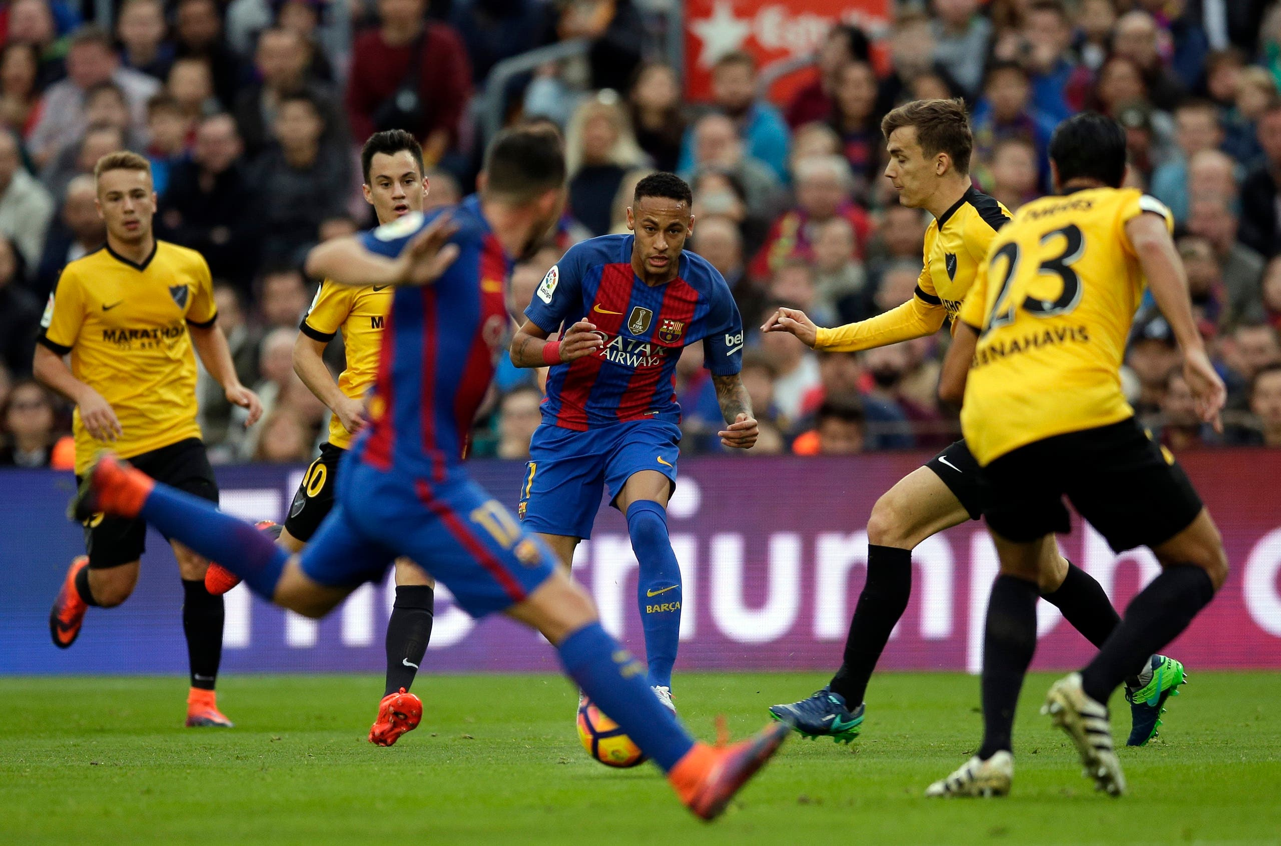 FC Barcelona's Neymar, center background, kicks the ball during the Spanish La Liga soccer match between FC Barcelona and Malaga at the Camp Nou in Barcelona, Spain, Saturday, Nov. 19, 2016. (AP)