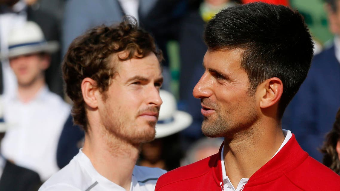 Djokovic delivers a speach next to Murray. REUTERS