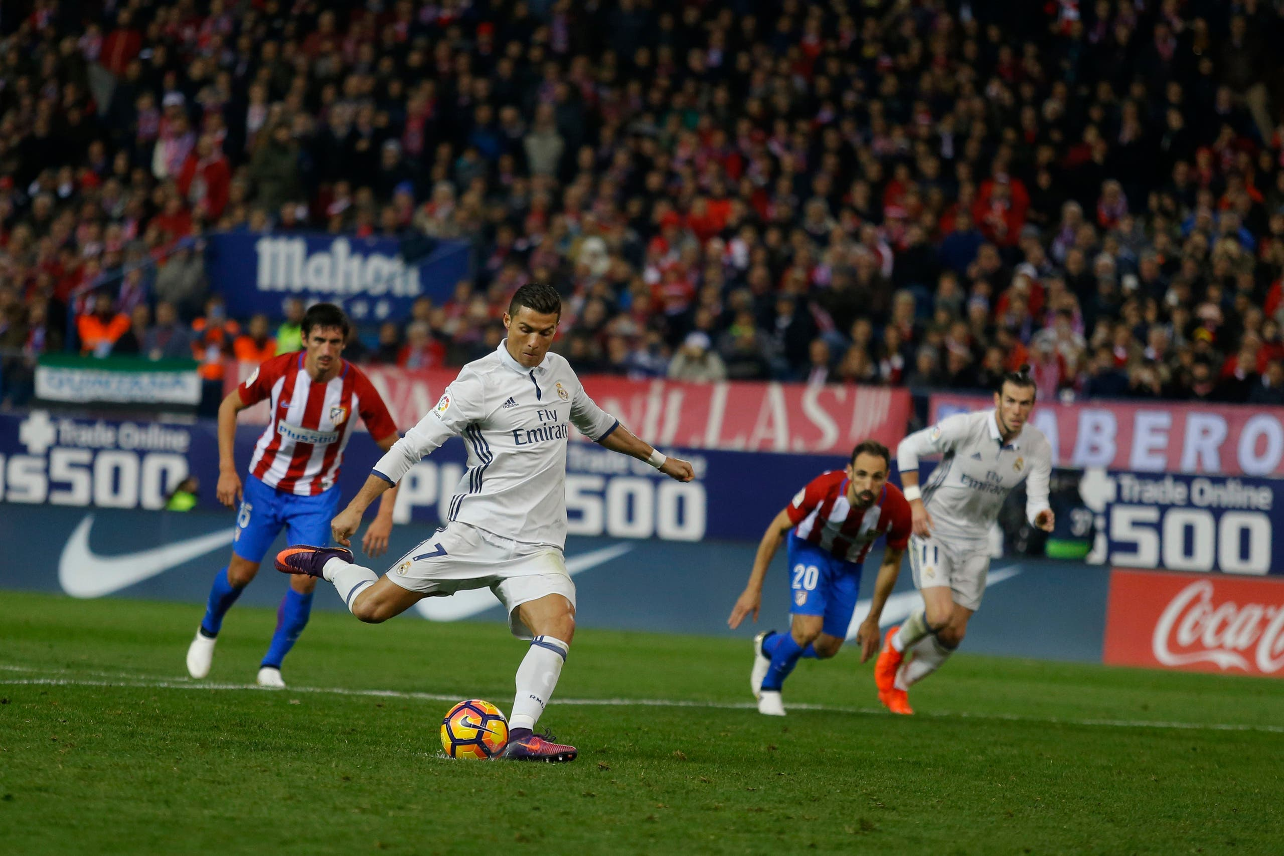Real Madrid's Cristiano Ronaldo shoots a penalty kick to score his side's second goal against Atletico Madrid during a Spanish La Liga soccer match between Real Madrid and Atletico Madrid at the Vicente Calderon stadium in Madrid, Saturday, Nov. 19, 2016. Ronaldo scored a hat trick in Real Madrid 3-0 victory. (AP)