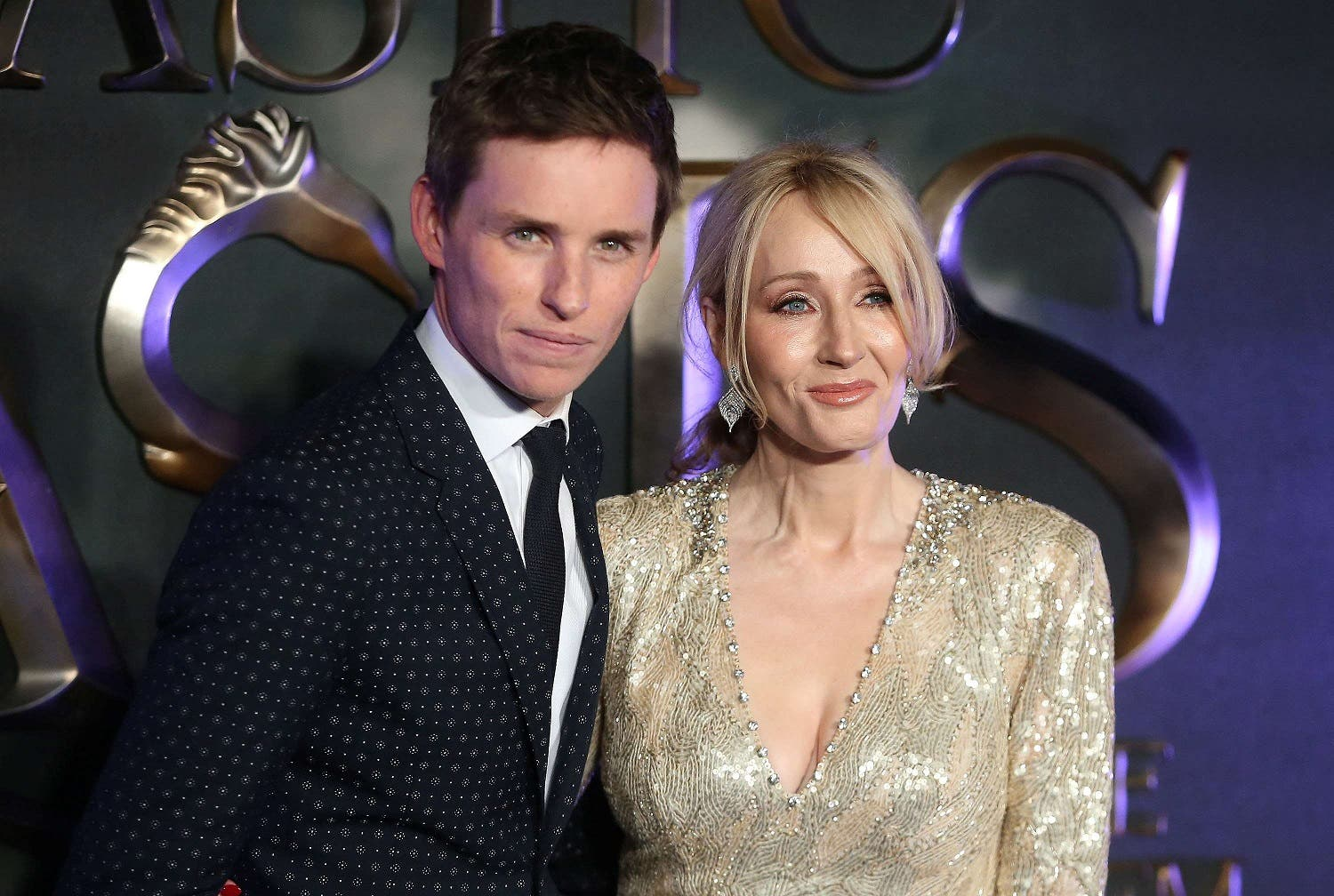 Actor Eddie Redmayne (L) poses with writer J.K. Rowling as they arrive for the European premiere of the film 'Fantastic Beasts and Where to Find Them' in London, Britain November 15, 2016. (Reuters)