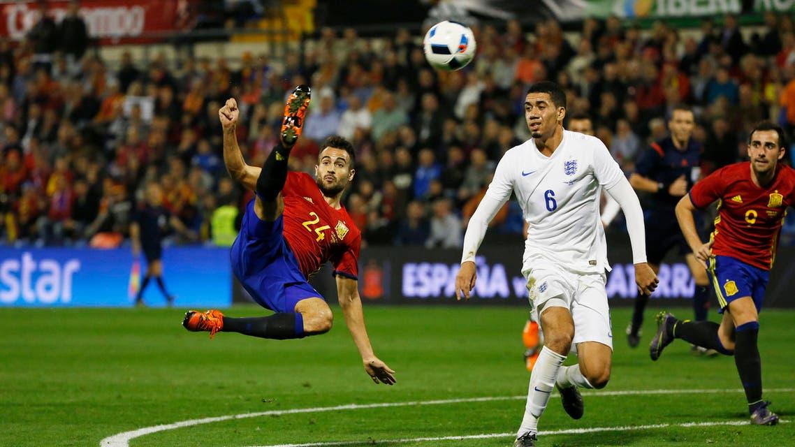 Spain's Mario Gaspar scores against England in their friendly international in Alicante, Spain, on Friday night. Spain won 2-0. | REUTERS