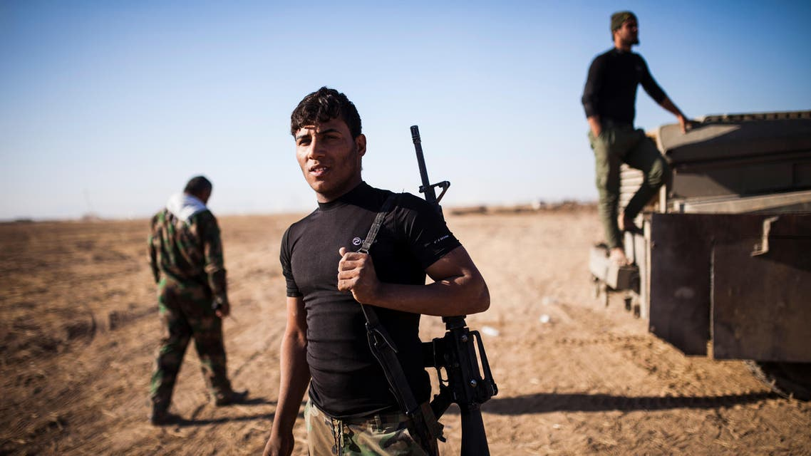 Members of the Hashd Al Shaabi (Popular Mobilisation Units) are seen on their way to Tal Afar airport on November 20, 2016. Pro-government paramilitary forces advancing on the town of Tal Afar, which commands the city's western approaches, entered its airport, while troops moving up from the south had the Mosul airport in their sights. Achilleas Zavallis / AFP