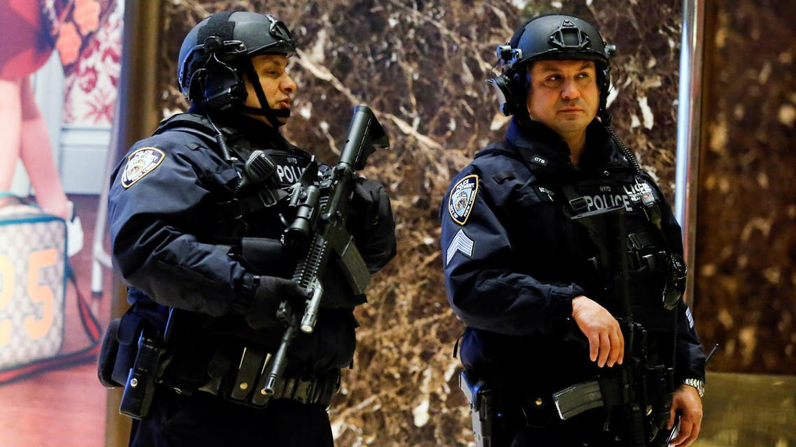 New York Police Department (NYPD) officers patrol inside Republican president-elect Donald Trump's Trump Tower in New York, U.S. November 12, 2016. REUTERS