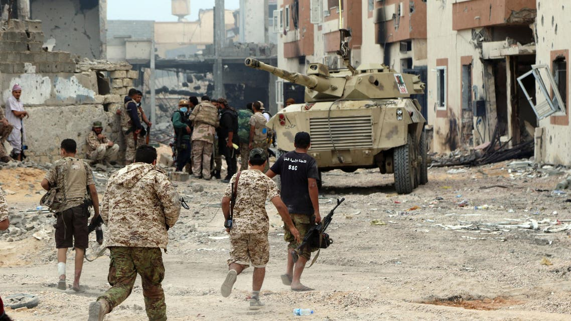 Forces loyal to Libya's Government of National Accord (GNA) hold a position in Sirte's Al-Giza Al-Bahriya district on November 21, 2016, during clashes with Islamic State (IS) group jihadists to retake control of the Mediterranean coastal city.