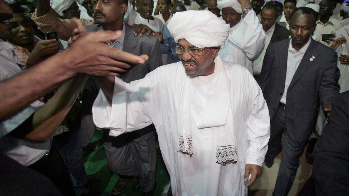 Sudan's president Omar al-Bashir, center, is congratulated by his supporters at the ruling party headquarters in Khartoum, Sudan, Monday, April 26, 2010. Sudan's president won another term in office Monday with a comfortable majority in elections marred by boycotts and fraud allegations, becoming the first head-of-state to be re-elected while facing an international arrest warrant for war crimes. (AP