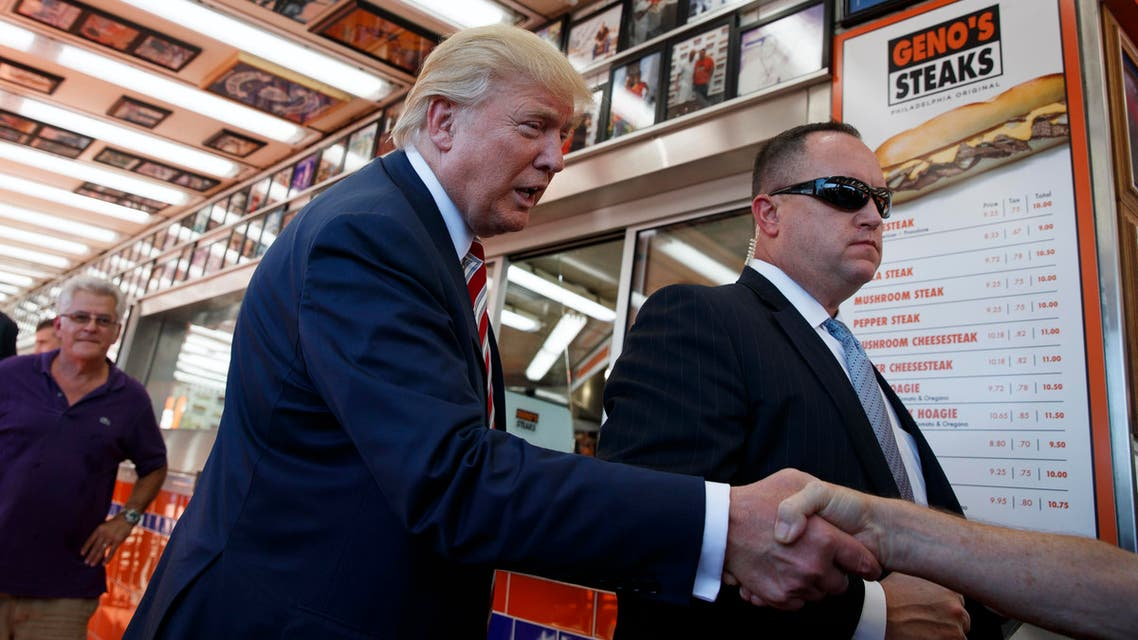 Republican presidential candidate Donald Trump shakes hands with customers during a visit to Geno's Steaks, Thursday, Sept. 22, 2016, in Philadelphia. (AP