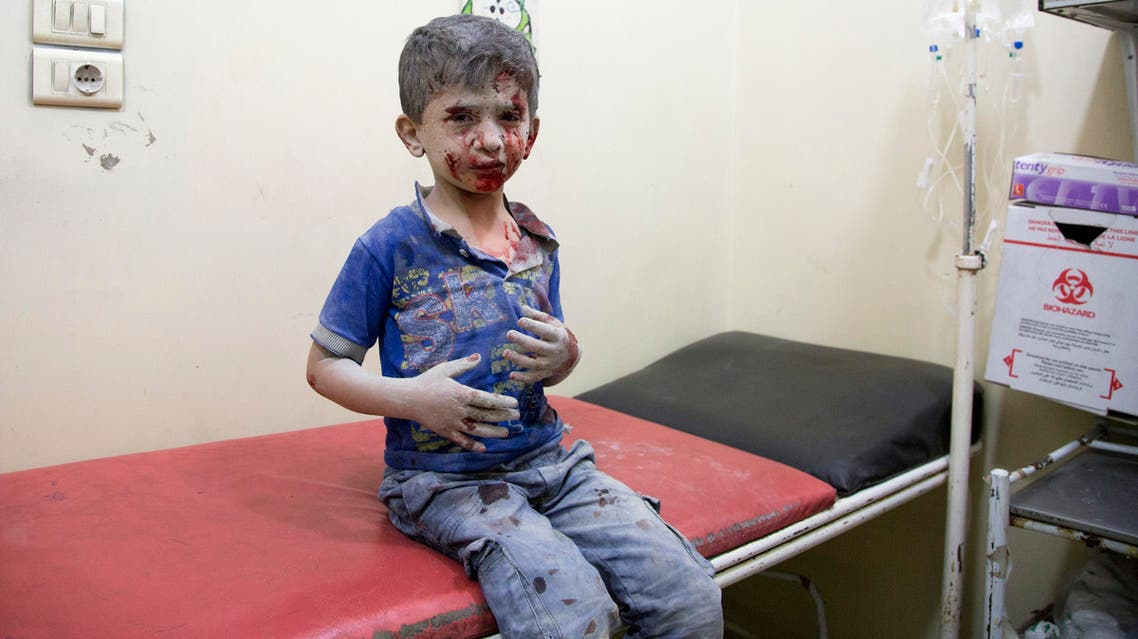 A Syrian boy receives treatment at a make-shift hospital following air strikes on rebel-held eastern areas of Aleppo on September 24, 2016. Heavy Syrian and Russian air strikes on rebel-held eastern areas of Aleppo city killed at least 25 civilians on Saturday, the Britain-based Syrian Observatory for Human Rights said, overwhelming doctors and rescue workers.  KARAM AL-MASRI / AFP