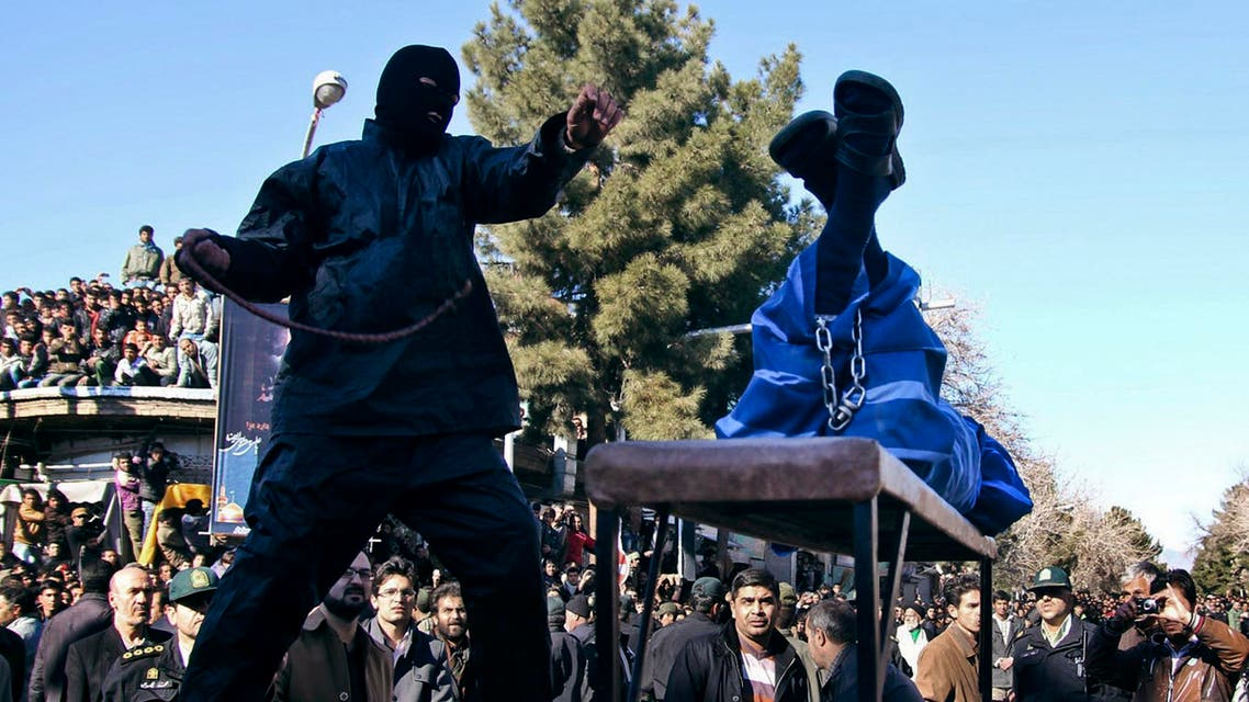 n Iranian officer lashes a man, convicted of rape, at the northeastern city of Sabzevar, Iran, Wednesday, Jan. 16, 2013.  AP