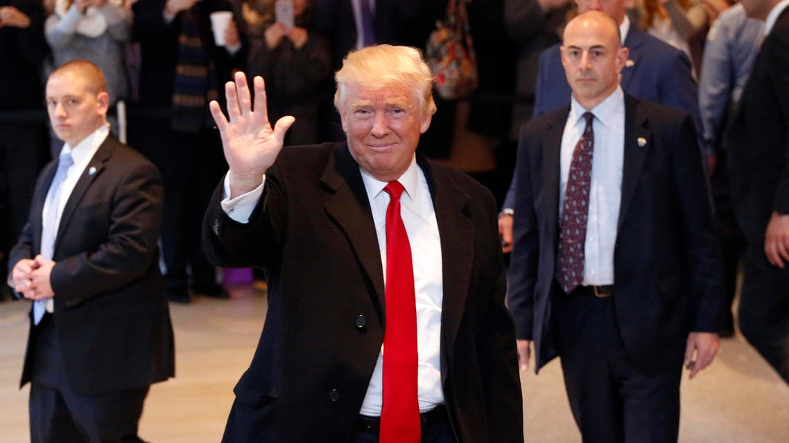 President-elect Donald Trump waves to the crowd as he leaves the New York Times building following a meeting, Tuesday, Nov. 22, 2016, in New York. (AP)