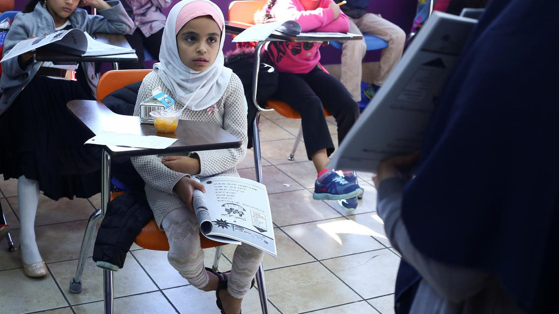 Muslim girl Saja Mashgar, 8, listens to her instructor during Arabic language studies at Masjid Al-Salaam, a mosque and Islamic community center in Dearborn, Michigan, US, on November 13, 2016. (Reuters)