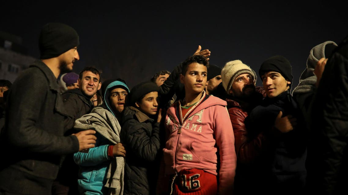 """Migrants queue to receive free tea near a derelict customs warehouse in Belgrade, Serbia, November 17, 2016. REUTERS/Marko Djurica SEARCH """"MIGRANTS WAREHOUSE"""" FOR THIS STORY. SEARCH """"WIDER IMAGE"""" FOR ALL STORIES."""