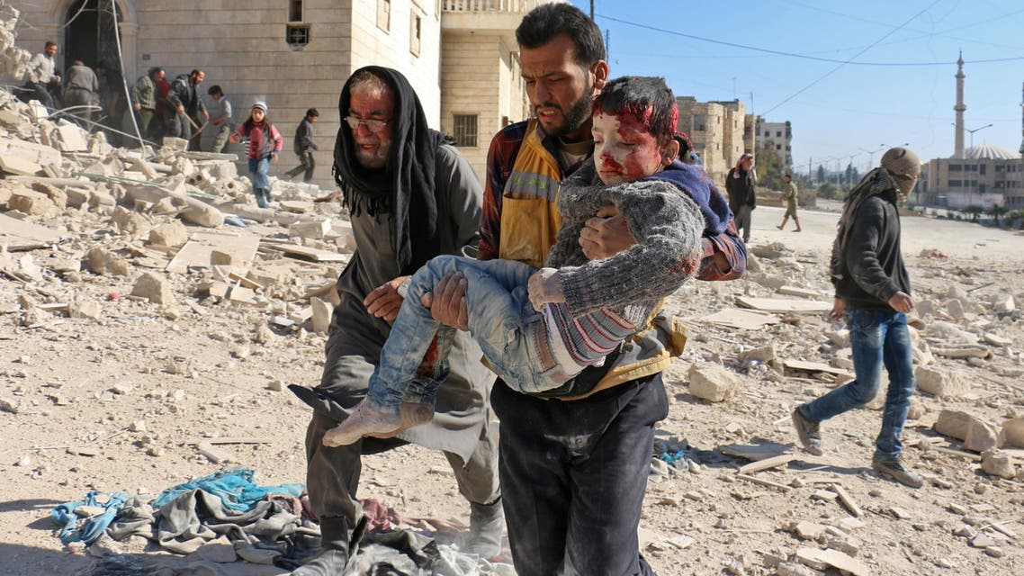 A Syrian civil defense volunteer, known as the White Helmets, carries a boy rescued from the rubble following a reported barrel bomb attack on the Bab al-Nairab neighborhood of Aleppo on November 24, 2016. (AFP)