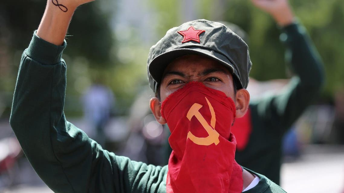 A Filipino activist uses a cloth printed with the hammer and sickle symbol to cover his face during a rally near the Malacanang presidential palace in Manila, Philippines Monday, Aug. 22, 2016. Philippine President Rodrigo Duterte recently reimposed an indefinite cease-fire after communist guerrillas declared their own truce as both sides resume talks aimed at ending one of Asia's longest-running rebellions. (AP Photo/Aaron Favila)