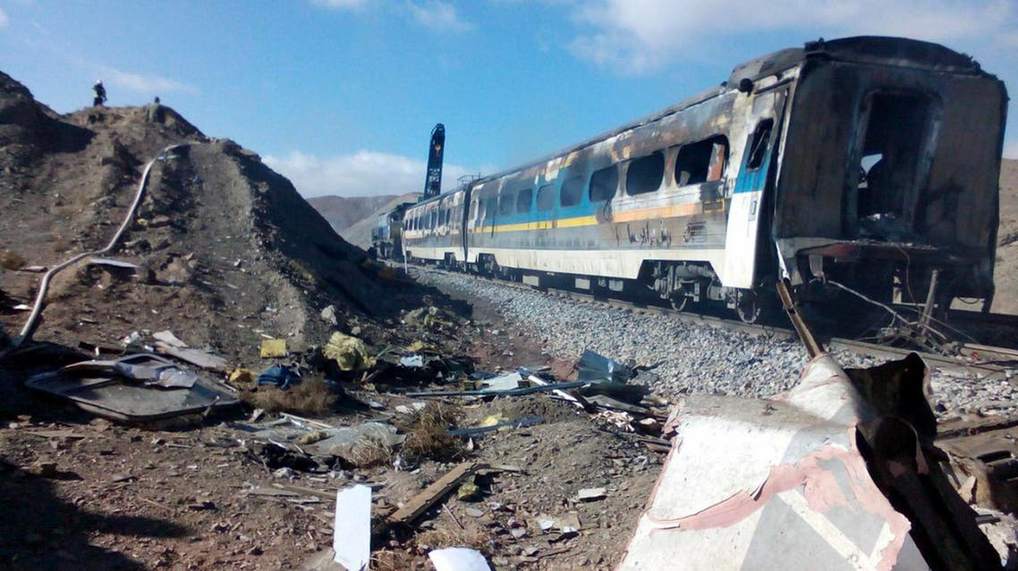 This picture released by Iranian Fars News Agency shows the scene of two trains collision about 150 miles (250 kilometers) east of the capital Tehran, Iran, Friday, Nov. 25, 2016. (AP)