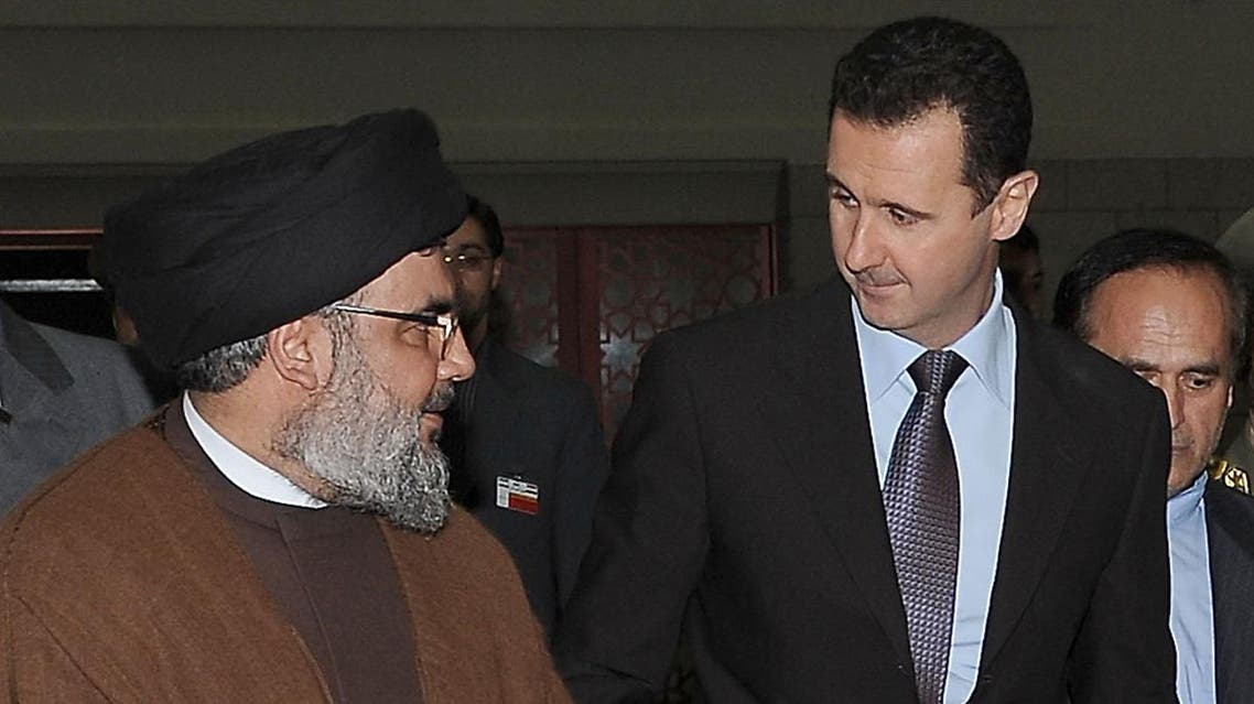 A handout picture released by the Syrian Arab News Agency (SANA) shows (L-R) Lebanon's Hezbollah chief Hassan Nasrallah, Syrian President Bashar al-Assad and his Iranian counterpart Mahmoud Ahmadinejad arriving for an official dinner in Damascus late on February 25, 2010. The presidents of Syria and Iran have signed a visa-scrapping accord, signalling even closer ties and brushing aside US efforts to drive a wedge between the two allies. AFP PHOTO/HO/SANA == RESTRICTED TO EDITORIAL USE == SANA / AFP