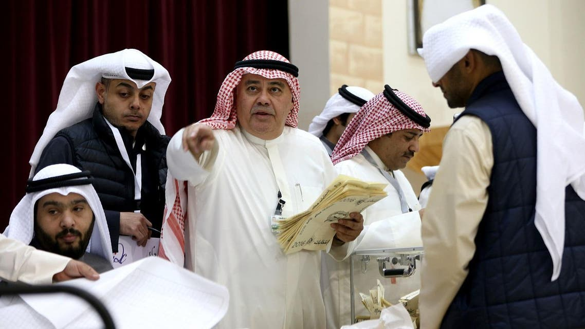 A Kuwaiti judge (C) and his aides count the ballots at a polling station at the end of the vote in the Sabah al-Salem district on the outskirts of Kuwait city. (AFP)