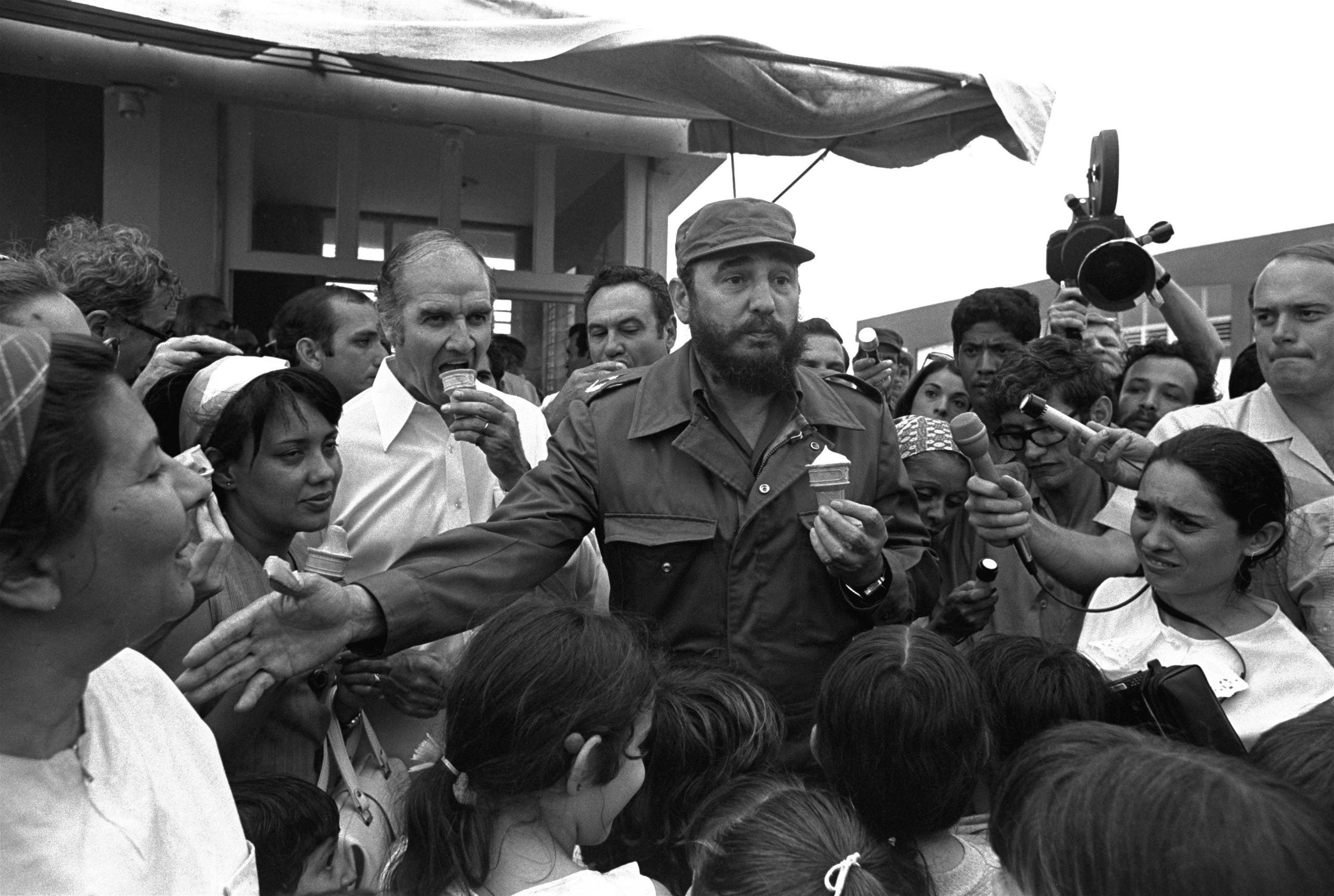 Cuban Prime Minister Fidel Castro treats visiting Senator George McGovern, D-SD, to ice cream Wednesday, May 8, 1975, in Jibacoa, Cuba, a milk-producing town near Havana. Sen. McGovern and Castro visited family homes and met local residents. (AP)