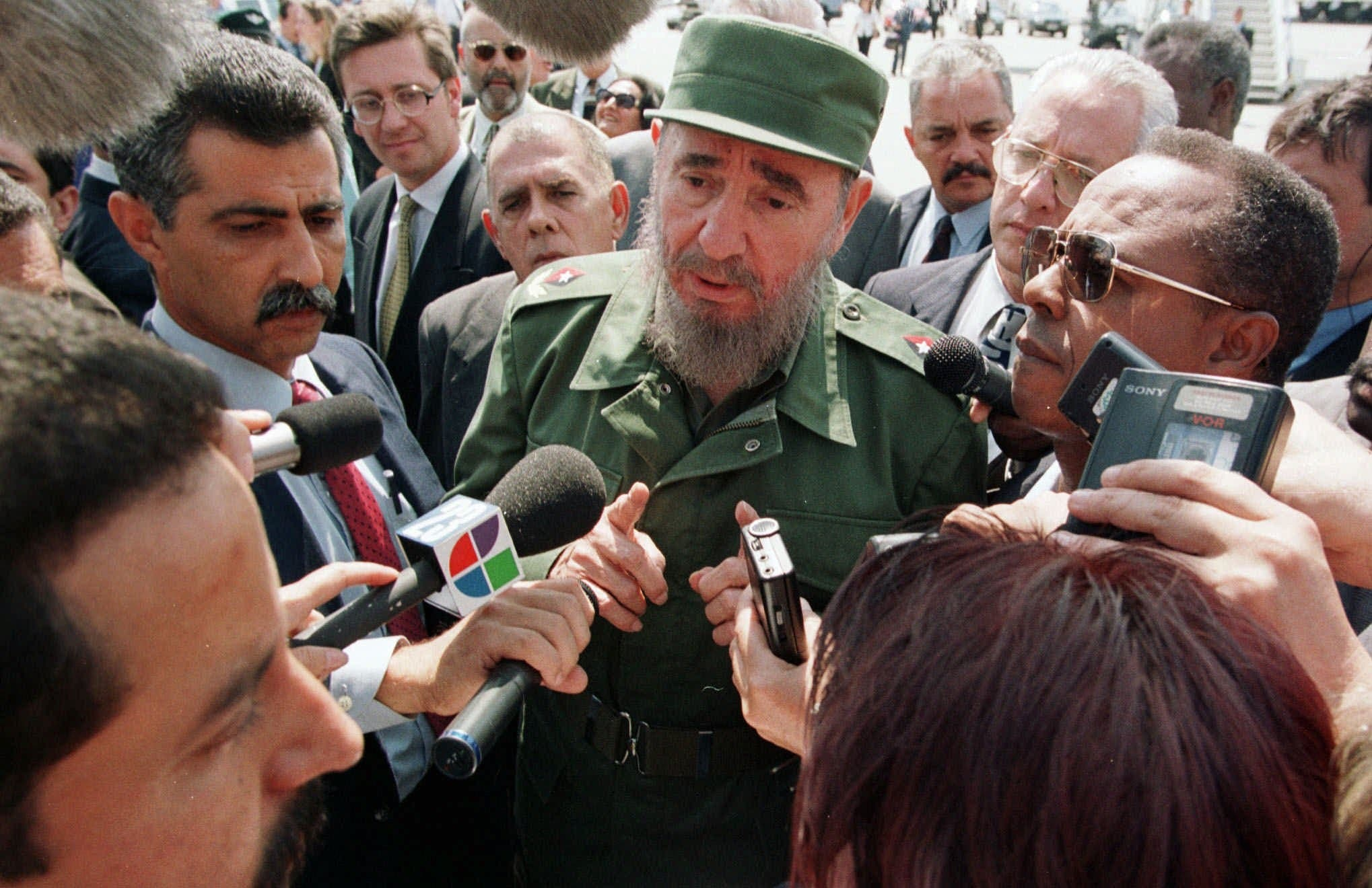Cuba leader Fidel Castro speaking to journalists on his arrival in Geneva Wednesday, May 13 1998, to participate in the 50th anniversary of the WHO (World Health Organisation) on Thursday, May 14, and also the 50th anniversary of the WTO (World Trade Organisation) on Monday, May 18. (AP)