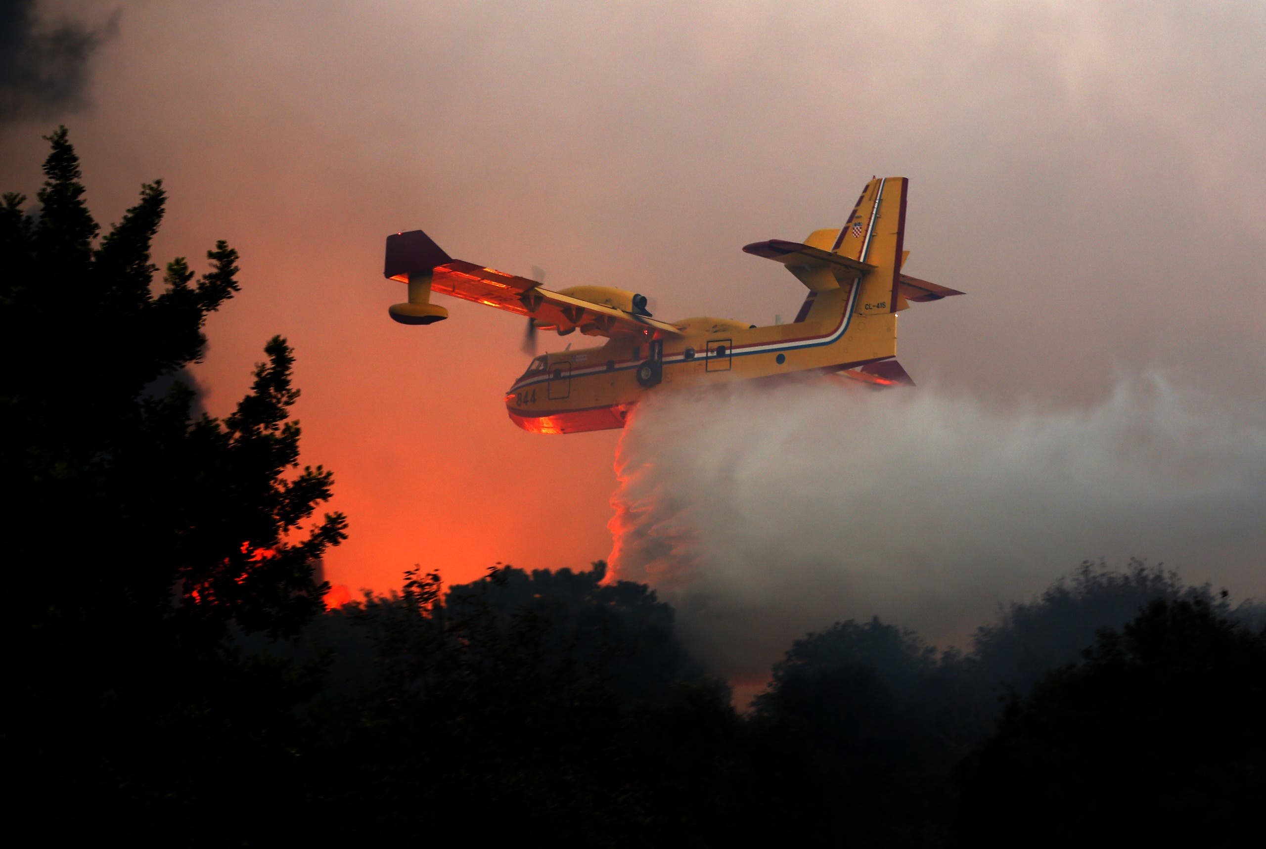 A Croatian firefighter plane helps extinguish a new fire that broke out in the Israeli town of Nataf, west of the Arab Israeli town of Abu Ghosh, along the border with the occupied West Bank on November 25, 2016. (AFP)
