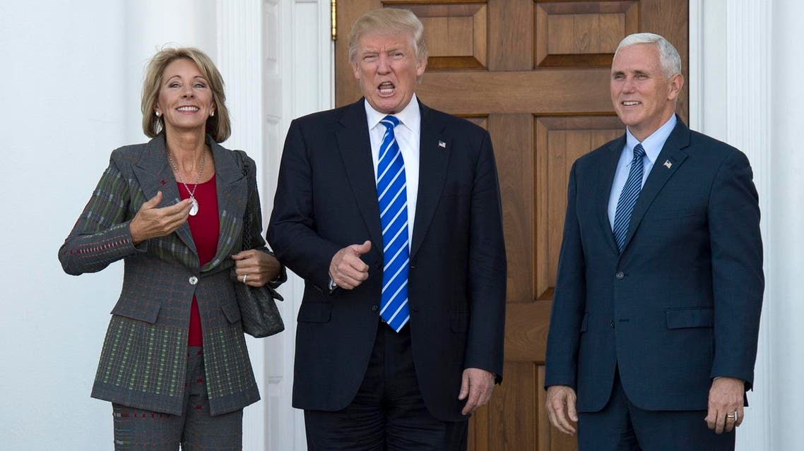 his file photo taken on November 19, 2016 shows US President-elect Donald Trump and Vice President-elect Mike Pence as they meet with businesswoman Betsy DeVos at Trump National Golf Club in Bedminster, New Jersey. President-elect Donald Trump intends to name Betsy DeVos as his nominee for Education Secretary, according to CNN. Don EMMERT / AFP