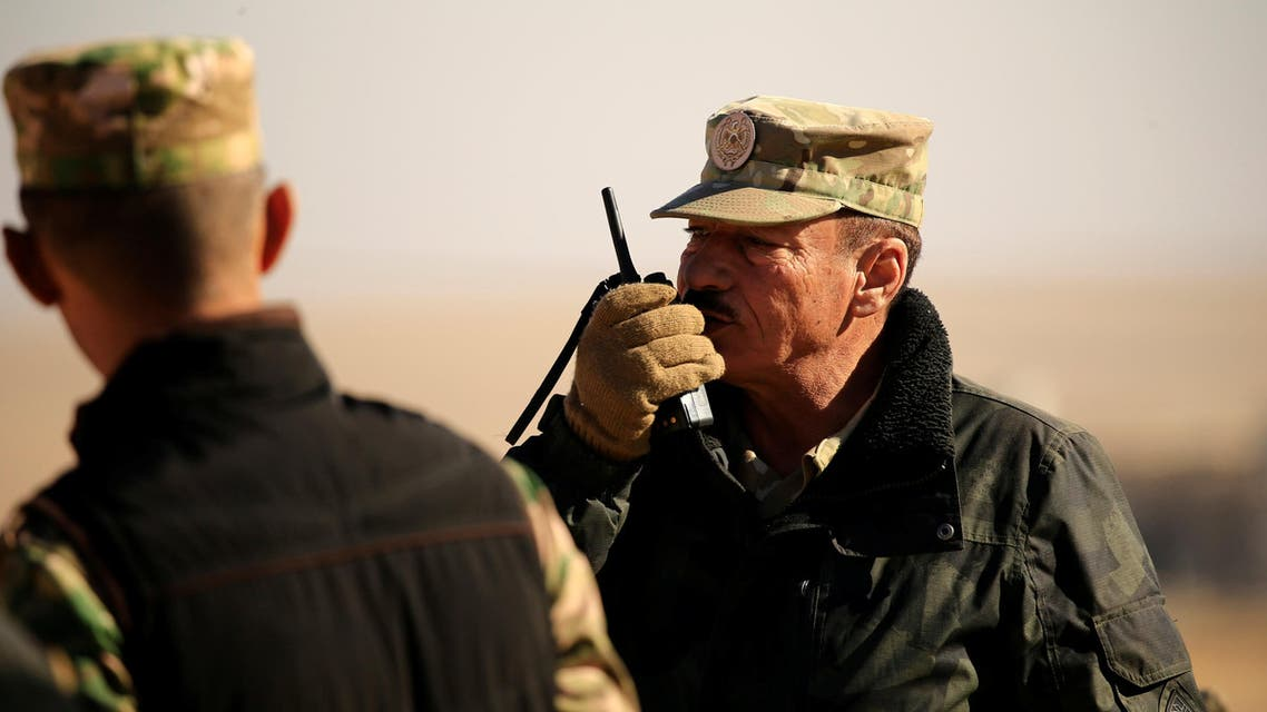 Nineveh Operations Commander Major General Najm al-Jubbouri uses a handheld radio during an operation against Islamic State militants southeast of Mosul, Iraq November 26, 2016. Picture taken November 26, 2016. REUTERS