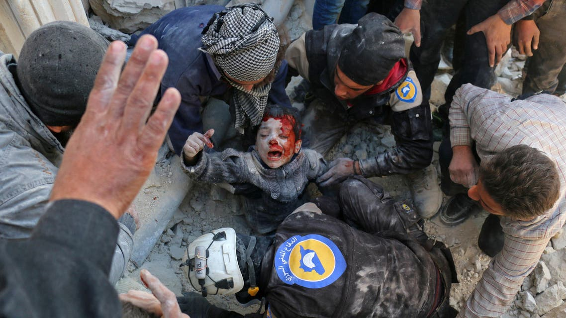 Syrian civil defence volunteers, known as the White Helmets, rescue a boy from the rubble following a reported barrel bomb attack on the Bab al-Nairab neighbourhood of the northern Syrian city of Aleppo on November 24, 2016. (AFP)