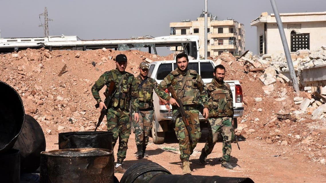 Syrian pro-government forces walk around in the village of Minyan, west of Aleppo. (AFP)