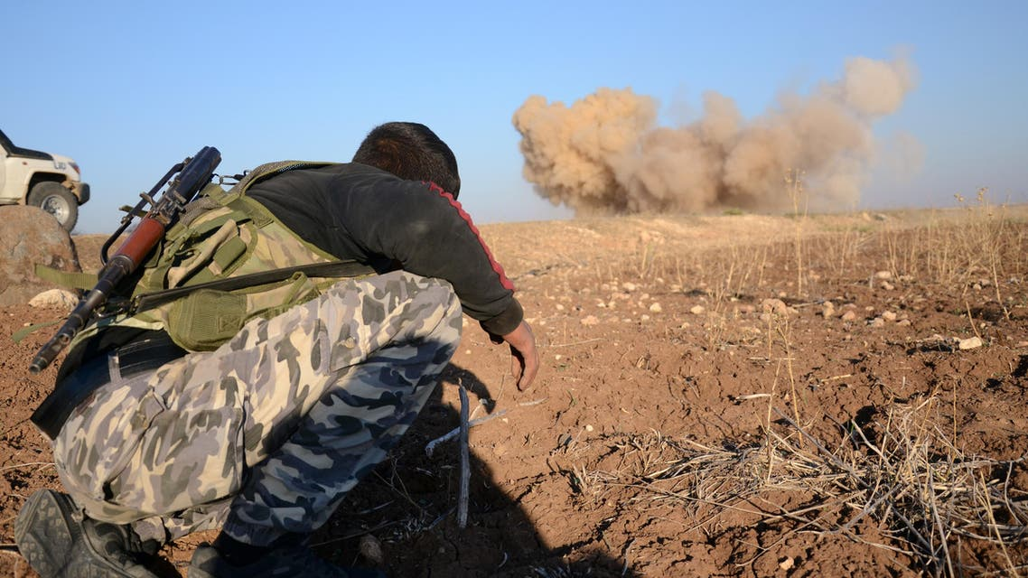A rebel fighter reacts as a landmine, planted by Islamic State (IS) group jihadists, is exploded by his comrades in the village of Tilalayn on the western outskirts of the northern Syrian town of Dabiq, on November 25, 2016.  Nazeer al-Khatib / AFP