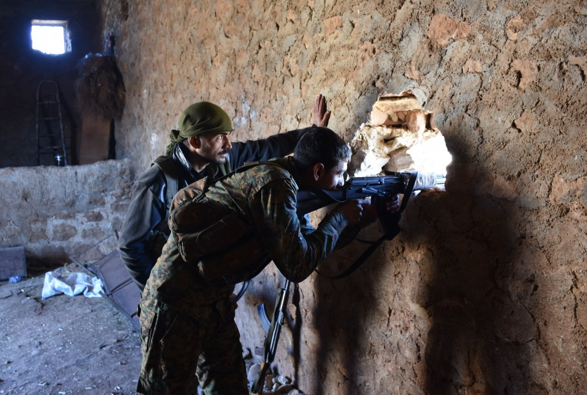 Clashes continue to rage in eastern Aleppo as the Syrian regime shelling of the area enters its 12th day and threats increase of division (AFP)