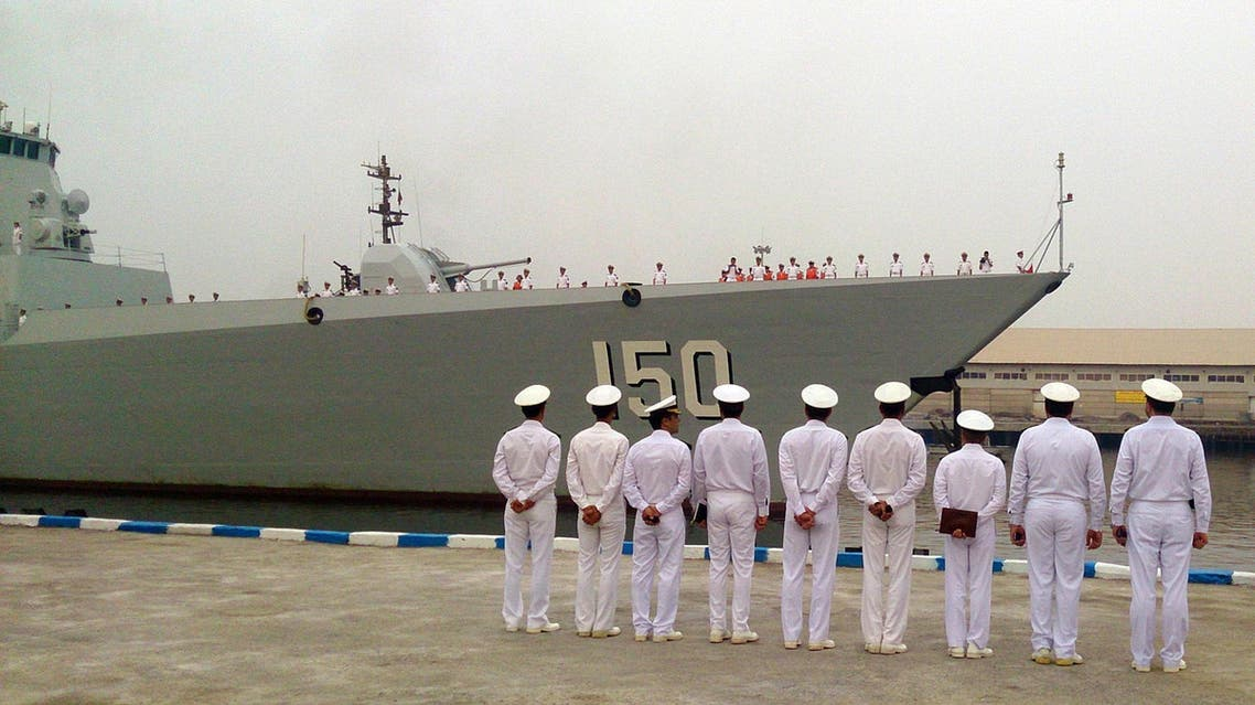 A handout photo provided by the Iranian news agency IRNA shows Iran's Navy officers lining up to welcome the Chinese Navy destroyer as it makes a landfall at the Iranian port of Bandar Abbas on the Gulf on September 20, 2014. (AFP)