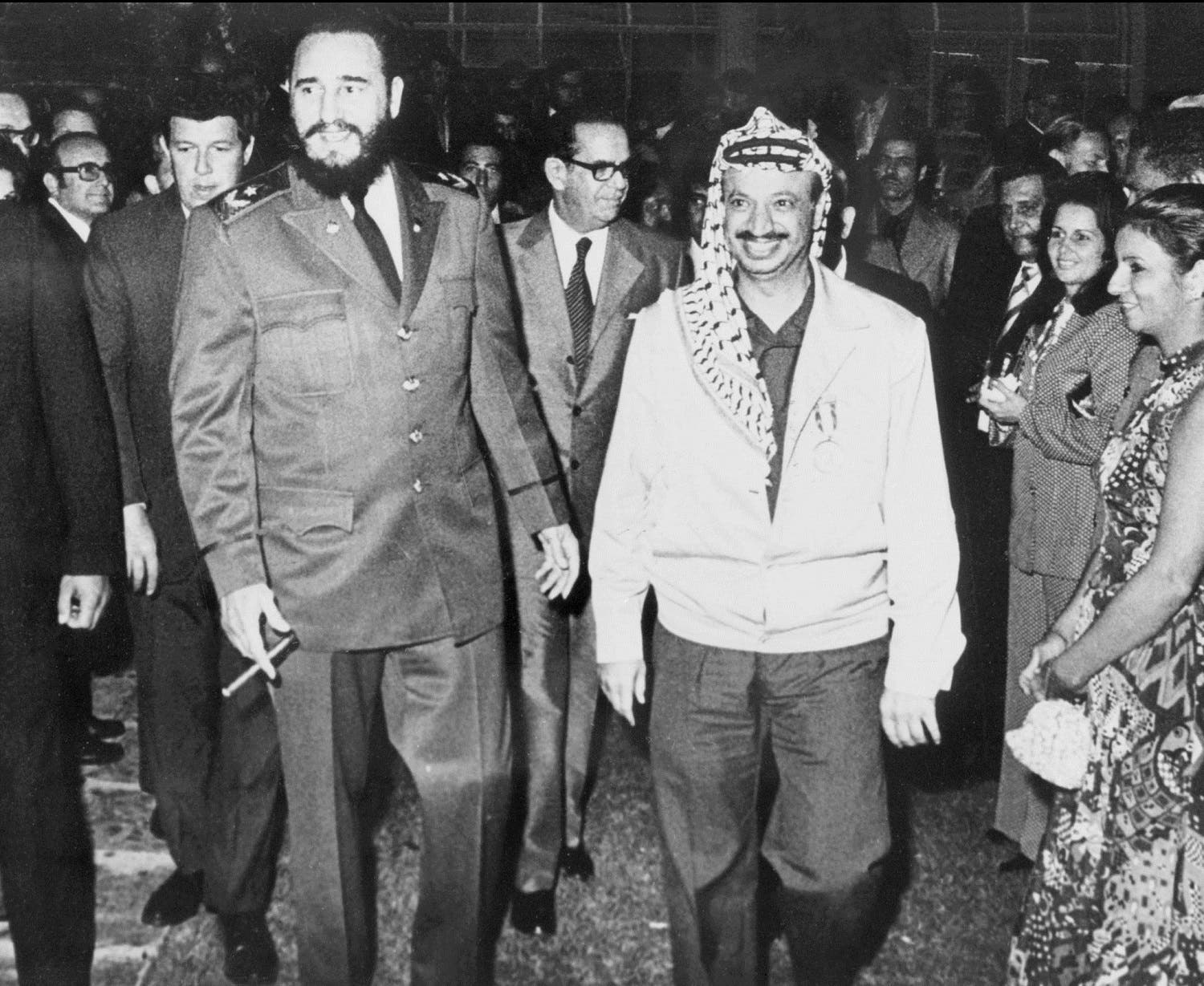 Yasser Arafat walks nearby Cuban leader Fidel Castro during his visit in Cuba in December 1974. Yasser Arafat found the Palestine Liberation Movement or Fatah in Kuwait in 1959 and gained control over the PLO in 1969. (AFP)
